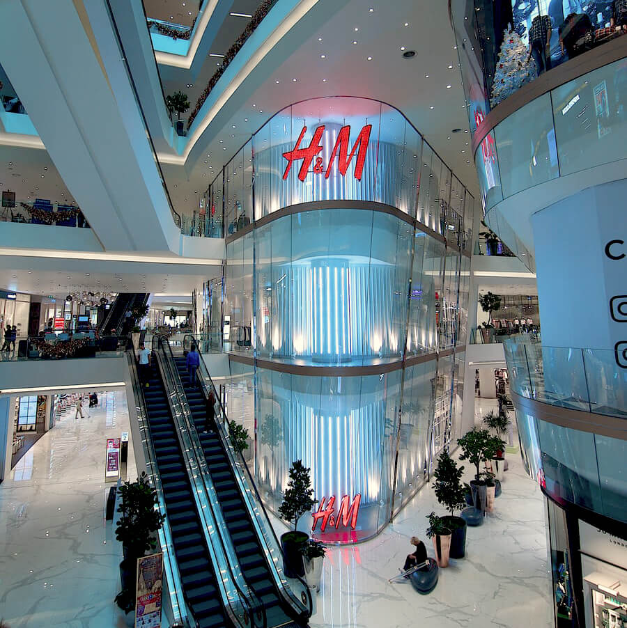 The exterior of an H&M store in a mall.