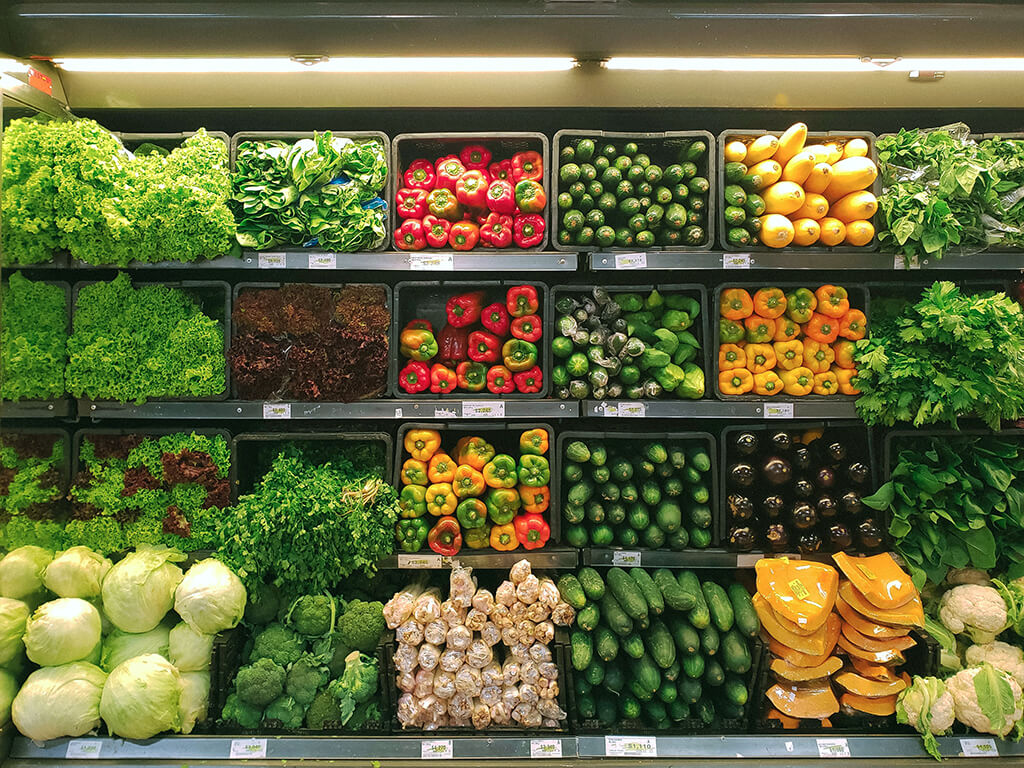 An abundant display of uniform vegetables at a grocery store